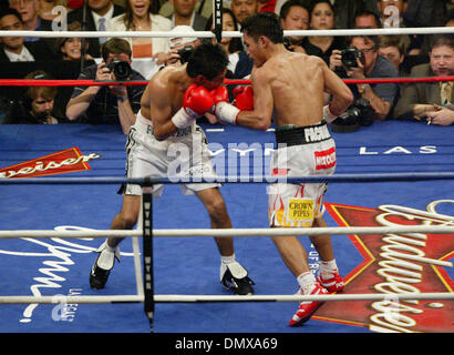 Jan 21, 2006; Las Vegas, NV, USA; MANNY PACQUIAO of the Philippines, right, connects with a left to ERIK MORALES, of Mexico, during their super featherweight boxing match Saturday night. Pacquiao won when the fight was stopped in the 10th round. Mandatory Credit: Photo by J.P. Yim/ZUMA Press. (©) Copyright 2006 by J. P. Yim