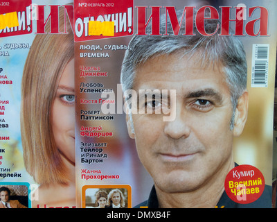 Hollywood movie star George Clooney appears on the cover of a glossy Russian magazine. - Stock Photo