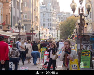 pedestrians out walking on Arbat in Moscow, Russian Federation - Stock Photo
