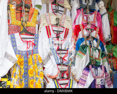Traditional Russian ladies costumes on sale at the Izmaylovo Market in Moscow, Russian Federation - Stock Photo