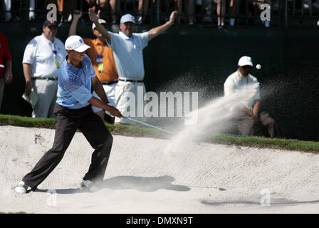 Mar 03, 2006; Miami, FL, USA; Tiger Woods hits out of the sand on the par three 4th hole. Woods saved par on the - Stock Photo