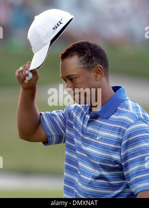 Mar 04, 2006; Miami, FL, USA; Tiger Woods tips his hat after completeing the third round. Mandatory Credit: Photo - Stock Photo