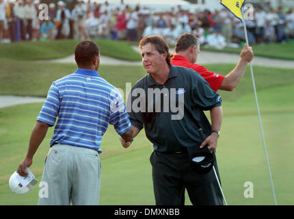 Mar 04, 2006; Miami, FL, USA; Tiger Woods and Phil Mickelson shake hands at conculsion of round three.  Mandatory - Stock Photo