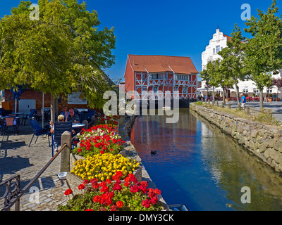 Half-timbered house Gewoelbe with Grube River, Hanseatic city of Wismar, Mecklenburg-Vorpommern, Germany - Stock Photo