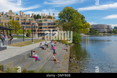 WASHINGTON, DC, USA - People on steps by Potomac RIver in Georgetown Waterfront Park. - Stock Photo