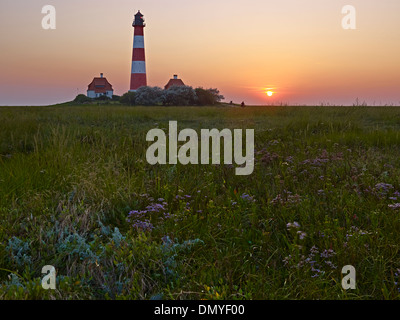 Sunset at the lighthouse Westerheversand, Eiderstedt peninsula, North Frisia, Schleswig-Holstein, Germany - Stock Photo