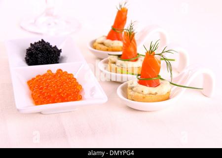 Smoked Lachsrollchen on white bread with caviar, horizontal - Stock Photo