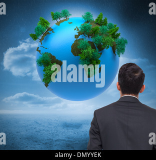 Composite image of digitally generated earth floating in air - Stock Photo