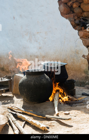 Boiling water on an open fire in a rural Indian village. Andhra Pradesh, India - Stock Photo