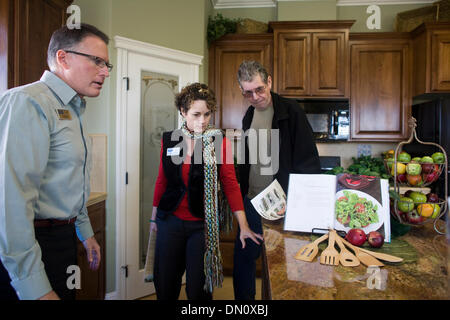 Jan. 27, 2010 - Redding, California, USA - Tom Papac, a real estate agent for Coldwell Banker, shows a house to - Stock Photo