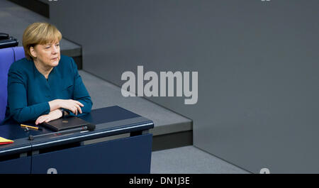 Berlin, Germany. 18th Dec, 2013. German Chancellor Angela Merkel sits in the German Bundestag in Berlin, Germany, - Stock Photo