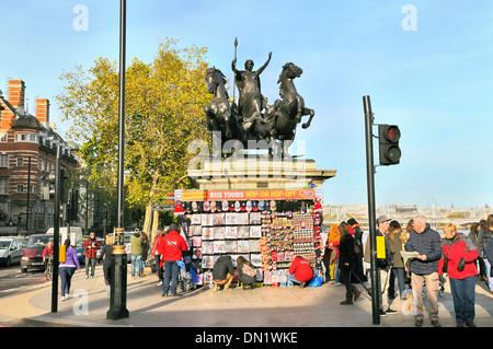 Tourists browsing souvenir stall beneath the Chariot of Boadicea, Westminster, London, England, UK - Stock Photo