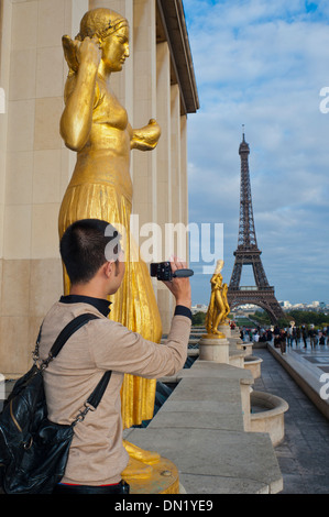 Paris, France, Young Chinese Man, Tourist, Standing near Eiffel Tower, Taking Photos - Stock Photo