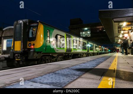 London Midland regional passenger train waiting to leave Stafford railway station as light fades - Stock Photo