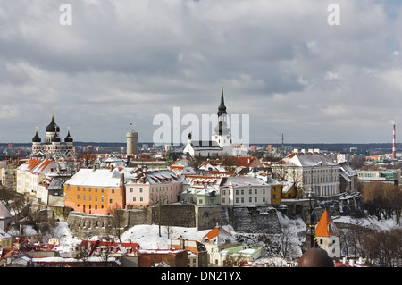 Historic Old Town of Tallinn, capital of Estonia. Roofs of houses are covered with snow. - Stock Photo