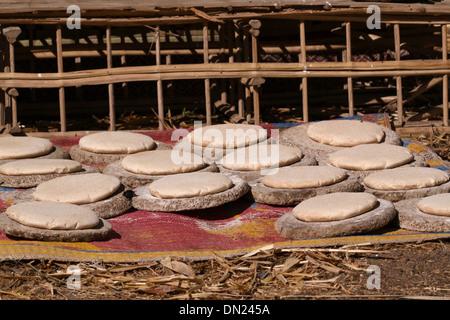 Bread baking  in the sun ( Sun Bread ) Upper Egypt - raising  the dough in the sun . - Stock Photo