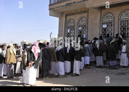 (131218) -- SANAA, Dec. 18, 2013 (Xinhua) -- The Yemeni people line up to get tickets in order to receives food - Stock Photo
