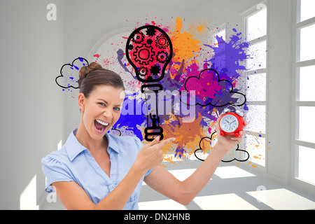 Composite image of businesswoman indicating alarm clock - Stock Photo