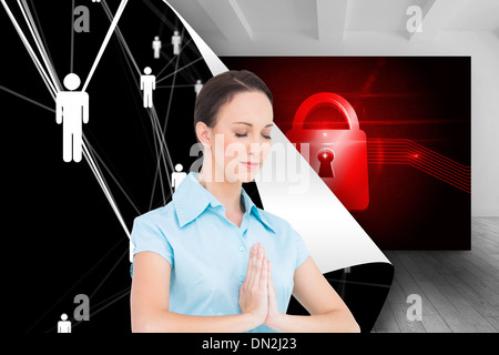 Composite image of peaceful young businesswoman praying - Stock Photo