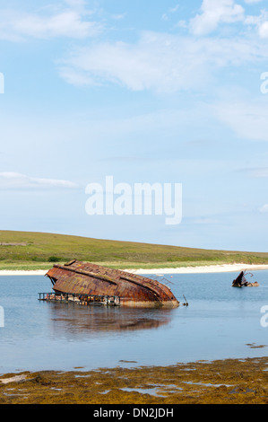 Remains of a blockship in eastern Weddell Sound next to Churchill Barrier 3 between Glimps Holm and Burray, Orkney. - Stock Photo