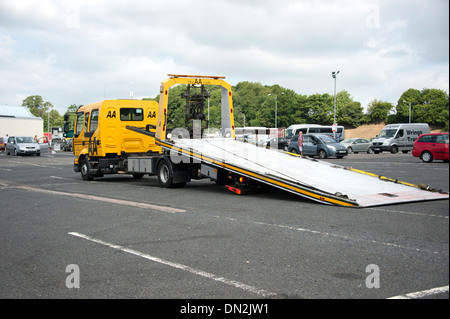 Car breakdown recovery vehicle truck low loader AA - Stock Photo