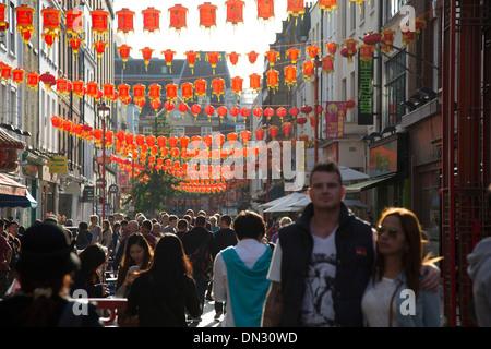 Lanterns along Gerrard Street in Chinatown. Soho, London, UK. Home to London's Chinese community. - Stock Photo