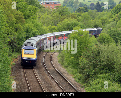 Train on a viaduct on the outskirts of Stroud, Gloucestershire - Stock Photo