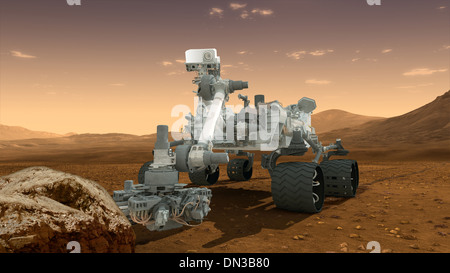 Space Mars Science Laboratory Curiosity rover examines a rock - Stock Photo