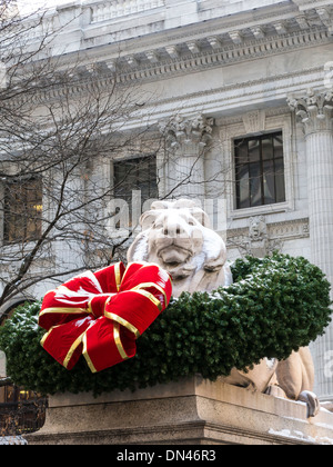 Lion Statue with Wreath during the Holidays, New York Public Library, Main Branch, NYC - Stock Photo