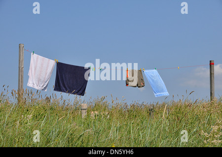 Laundry hanging to dry on a washing line, Schleswig-Holstein, Germany - Stock Photo