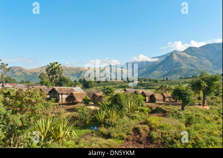 Huts in the village of the Antandroy people, mountainous landscape, near Fort-Dauphin or Tolagnaro, Madagascar - Stock Photo
