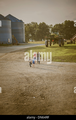 Caucasian family walking on farm - Stock Photo