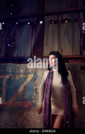 Fashion portrait of woman in dress in an abandoned warehouse - Stock Photo