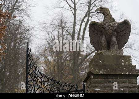 Eagle statues atop of entrance gate posts to country houses - Stock Photo