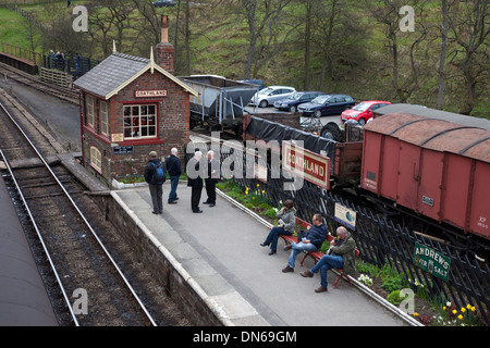 People Waiting for a Train on the Platform of Goathland Railway Station North Yorks Moor Railway Yorkshire UK - Stock Photo