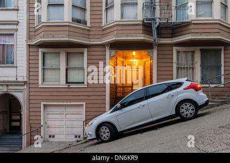 Car parked in a steep street, San Francisco, California, USA - Stock Photo