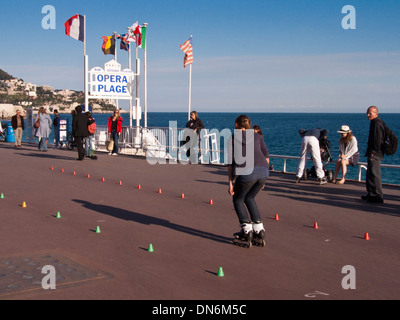 Roller-blader going through some moves on Nice promenade in France - Stock Photo