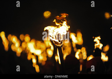 Flaming torches pass through the streets of Lewes, East Sussex on Bonfire Night, November 5th - Stock Photo
