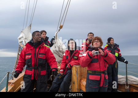 Tourists on a whale watching boat in Skjalfandi Bay, Husavik, Iceland. - Stock Photo