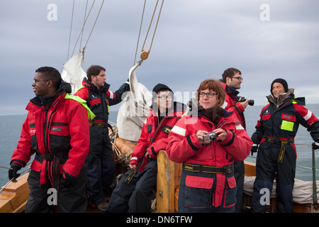 Tourists on a whale watching boat in Skjalfandi Bay, Iceland. - Stock Photo