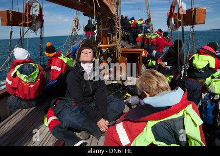 On whale watching boat in Skjalfandi Bay, Husavik, Iceland. - Stock Photo