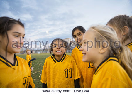 Soccer team on field at dusk - Stock Photo