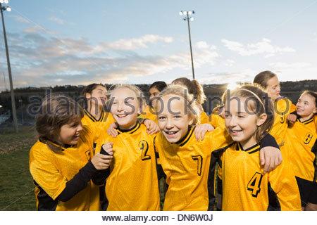 Girls soccer team on field - Stock Photo