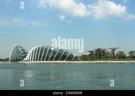 Building at the Gardens By The Bay. Singapore. People in Kayaks in foreground. - Stock Photo