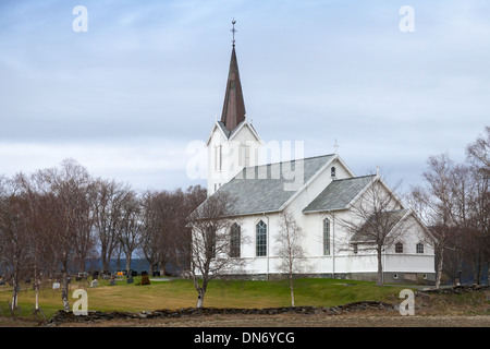 Traditional white wooden Norwegian Lutheran Church in small village - Stock Photo