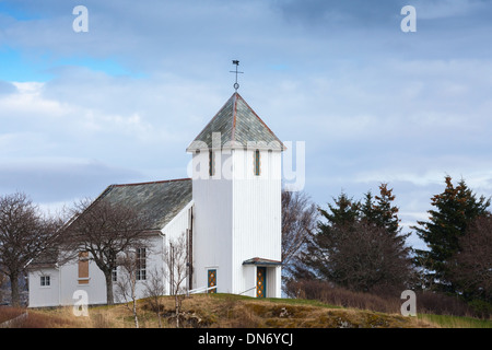 Traditional white wooden Norwegian Lutheran Church in small town - Stock Photo