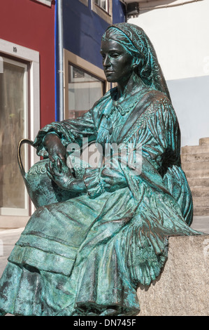 Woman Statue in the streets of the old city, Coimbra, Beira Province, Portugal - Stock Photo