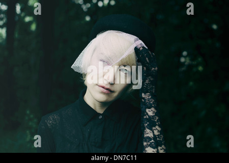 Woman wearing outfit for funeral - Stock Photo