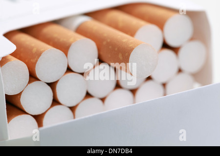 Closeup of cigarettes in a pack, shallow depth of field - Stock Photo