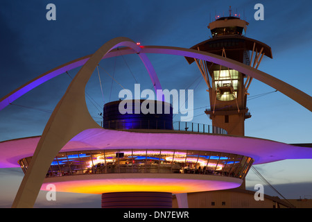 Theme Building and tower of Los Angeles International Airport at dusk - Stock Photo